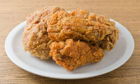Cuisine and Food, Close Up of A Plate of Delicious Crispy Fried Chicken on Brown Wooden Table.