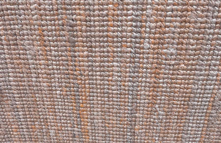 Background Pattern, Horizontal Texture of Brown Weaving Fabric Doormat with Copy Space for Text Decoration.