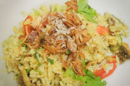 Thai Food and Cuisine, Green Curry Fried Rice and Salted Fish Served with Crispy Onions. Stock Photo