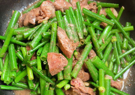 Chinese Cuisine and Food, Stir Fried Flowering Chinese Garlic Chives or Ku Chai with Chicken Livers.