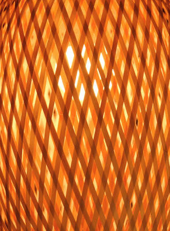 lamp shade: Close Up of Luxury Woven Bamboo Lamp with Yellow Light Inside. Stock Photo
