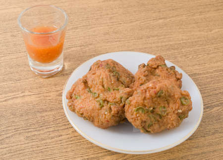 Cuisine and Food, Thai Traditional Fried Fish Cakes Served with Spicy Sauce. Stock Photo
