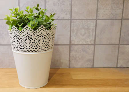 Artificial Green Plants in White Metal  Flower Pots on Wooden Table for Home and Office Decoration without The Care.