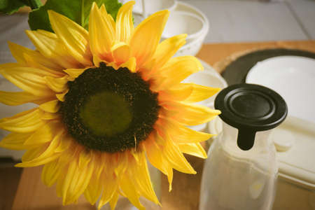 Yellow Artificial Sunflower Flowers The Kitchen Table for Home and Building Decoration.