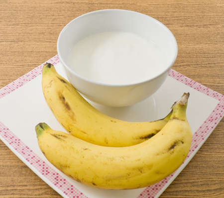 Bowl of Homemade Yoghurt Topping with Organic Banana, Nutritionally Rich in Protein, Calcium, Riboflavin, Vitamin B6 and Vitamin B12. Stock Photo