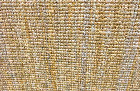 Background Pattern, Horizontal Texture of Brown and Yellow Weaving Fabric Doormat with Copy Space for Text Decoration.