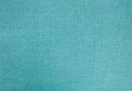 Textura da tela, fim acima do fundo azul do teste padrão da textura do tecido de algodão no tom das cores pastel. Foto de archivo