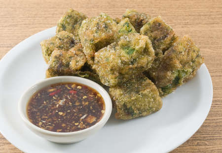 Fried Chinese Pancake or Fried Steamed Dumpling Made of Garlic Chives, Rice Flour and Tapioca Flour Served with Spicy Soy Sauce. Traditional Food of China.