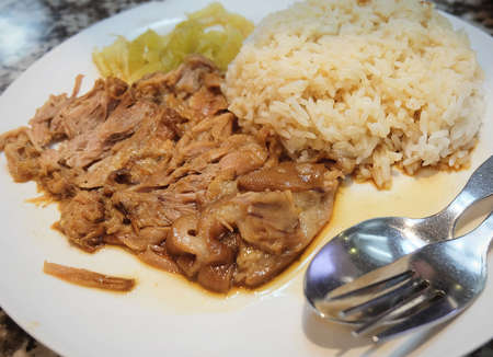 Chinese Cuisine, Traditional Pork Leg Stew with Five Spice on Rice Served with Pickled Cabbage. Stock Photo