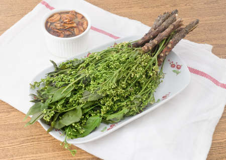 Thai Cuisine and Food, A Dish of Boiled Margosa or Neem Leaves and Blossom Served with Sweet Sauce.
