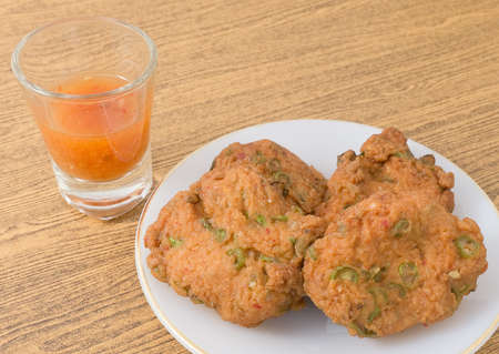 Cuisine and Food, Thai Traditional Fried Fish Cakes Served with Sweet Spicy Sauce. Stock Photo