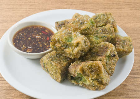 Plate of Fried Chinese Pancake or Fried Steamed Dumpling Made of Garlic Chives, Rice Flour and Tapioca Flour Served with Spicy Soy Sauce. Traditional Food of China.