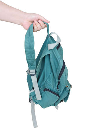 Close Up of Hand Holding Green Fabric Backpack. Made From Fine Canvas Isolated on White Background.  Stock Photo