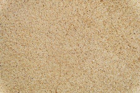 Hintergrundmuster, natürliche Beschaffenheit des Sandes mit kleinem Steinhintergrund mit Kopienraum für Text verziert.