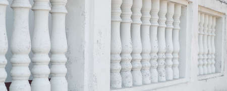 Row of White Plaster Sculpture Balusters or Balcony in Old and Ancient Building.