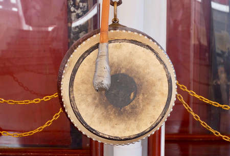 The Sacred Drum Hanging on Wooden Bar in A Temple. A Communication, Celebration and Healing Tool.