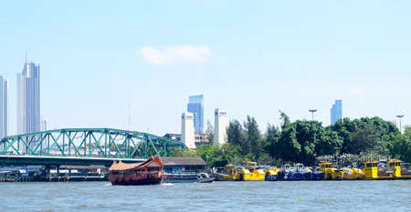 Row of Garbage Boat or Boat Machine to Collect The Floating Trash and Aquatic Weed in Chao Phraya River Bangkok, Thailand Stock Photo