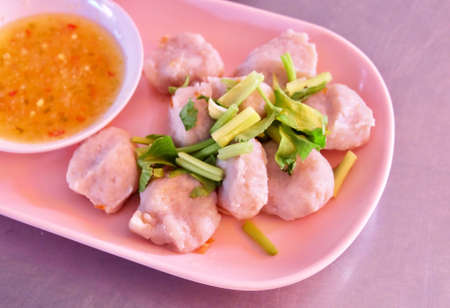 Food and Cuisine, Asian Style Fish Meatballs Served with Spicy and Sour Sauce. Stock Photo