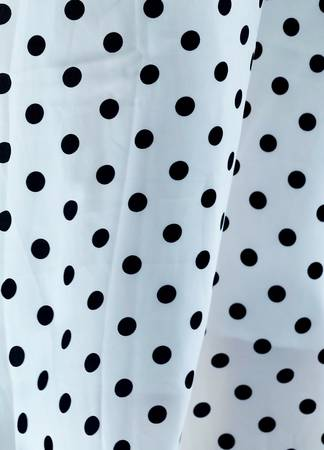 Fabric Texture, Close Up of Black and White Polka Dots Textile Pattern Background.