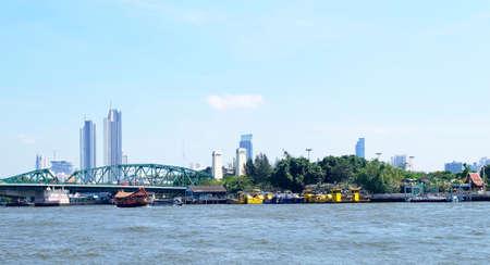 Bangkok Riverside, The Memorial Bridge or Phra Phuttha Yodfa Bridge with Thai Word Meaning Beware The Boat Crash The Bridge Over The Chao Phraya River Bangkok, Thailand.