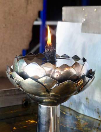 Gasoline Lamps or Oil Lamp in Lotus Shape In Thai Temple, Used to Worship, Pay Respect and Make Merit with The Buddha.