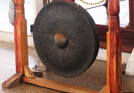 The Sacred Iron Gong Hanging on Bar in A Temple. A Communication, Celebration and Healing Tool. Stock Photo