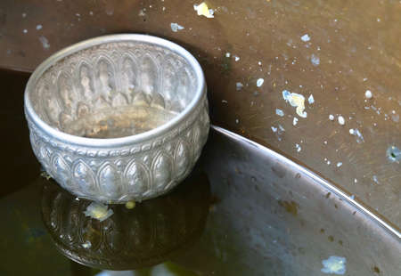 Empty Small Bowls Floating on The Holy Water or Blessed Water, Used to Drink, Cleaning The Body and Blessing for Protection and Good Luck.