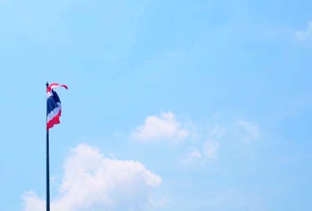 Democraycy Symbol, Waving Thai Flag in Red, White and Blue Stripe on The Pole with Blue Sky.