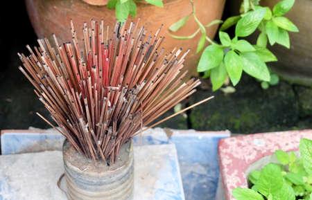 Burned Joss Sticks in Incense Burner.