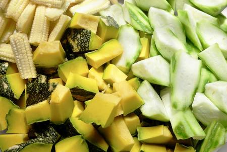 Vegetable, Closeup Raw Chopped Pumpkins, Angled Gourds or Sponge Gourds and Baby Corns. Stok Fotoğraf