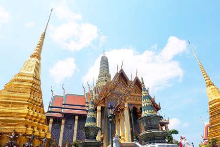 Beautiful Gold Pagodas and Monastery in Wat Phra Kaew Temple and The Grand Palace at Bangkok, Thailand.