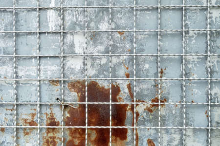 Close Up of Metallic Grille or Steel Grating on Rustic Metal Sheet Textured