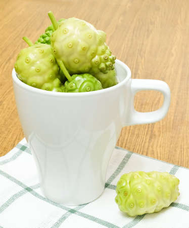 Vegetable and Herb, Noni, Morinda Citrifolia, Great Morinda, Indian Mulberry, Beach Mulberry or Cheese Fruits in A Cup with Polysaccharide, Vitamin A, C and Calcium. The Essential Nutrient for Life.