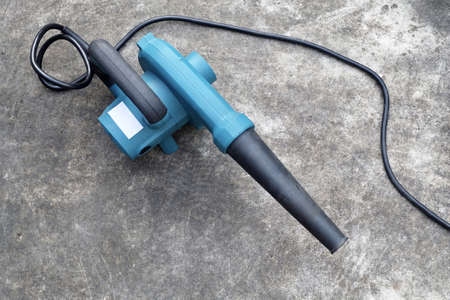 Blue Air Blower on Cement Floor, Use to Remove Dust From The Electrical Machine and Leaves in A Garden.