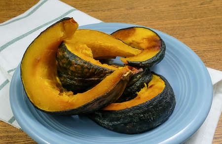 Cuisine and Food, Dish of Baked Slices Pumpkin High in Vitamin A, B, C and Minerals.