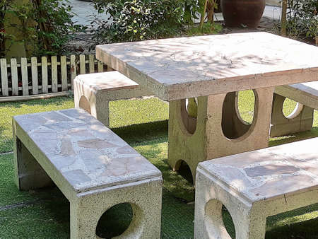 Set of Decorative Marble Stone Table and Chair Standing in A Beautiful Garden.