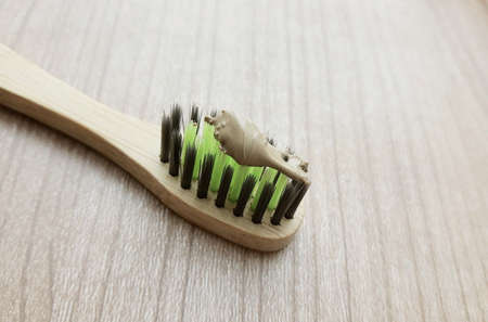 Wooden Bamboo Toothbrushes with Herbal Toothpaste Stock Photo