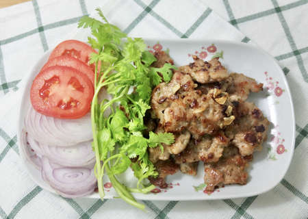 Cuisine and Food, Thai Traditional Deep Fried Marinated Minced Pork Served with Coriander and Tomatoes on White Dish.