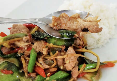 Thai Cuisine and Food, Stir Fried Pork with Spicy Herbs and Long Yard Beans Stock Photo