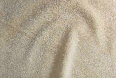Fabric and Textile, Close Up of Wavy Beige Cotton Towel or Terry Texture Background with Copy Space for Text Decoration. Stock Photo