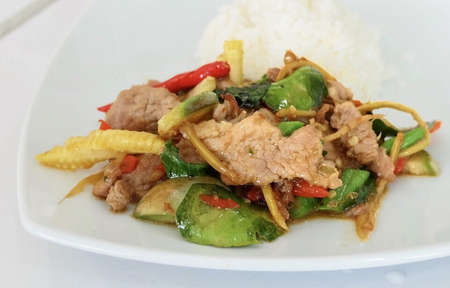 Thai Cuisine and Food, Stir Fried Pork with Spicy Herbs and Long Yard Beans 免版税图像