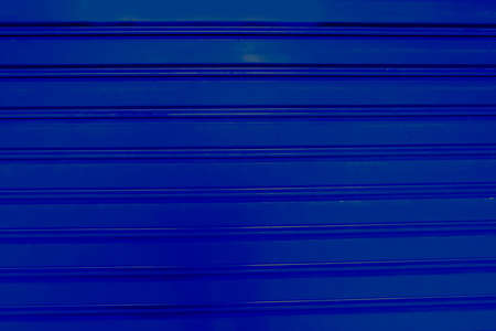Background Pattern, Horizontal Texture of Blue Corrugated Metal Sheet with Copy Space for Text Decorated.