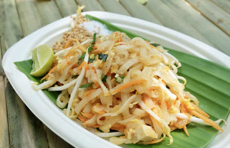 Thai Cuisine, Pad Thai or Thai Stir Fried Noodles and Dried Shrimps Served with Roasted Ground Peanuts, Lime and Sugar. One of The Most Popular Dish in Thailand.