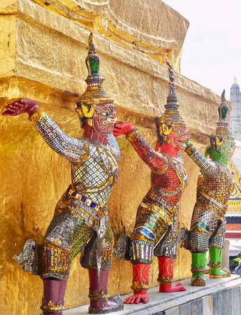 Demon Guardian Giant Statues Stand Around Pagoda and Liftting The Base of The Golden Pagoda at Wat Phra Kaew and The Grand Palace in Bangkok, Thailand. 新闻类图片