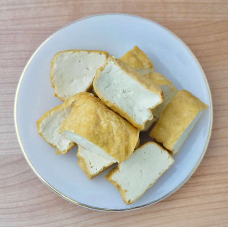 Cuisine and Food, Top View of Chinese Deep Fried Tofu or Fried Bean Curd Usually Served with Sweet and Sour Spicy Sauce. High in Vitamin B9, B1, B2 and K. Stock Photo
