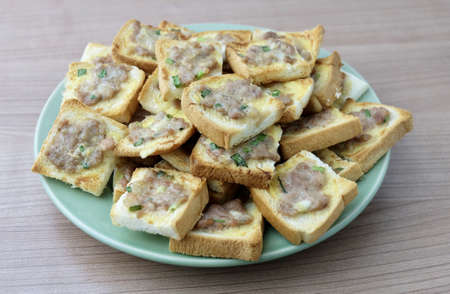 Cuisine and Food, Delicious Homemade Thai Fried Bread with Pork Spread Usually Served with Sweet Peanut Sauce.