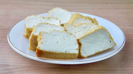 Cuisine and Food, Chinese Deep Fried Tofu or Fried Bean Curd Usually Served with Sweet and Sour Spicy Sauce. High in Vitamin B9, B1, B2 and K.
