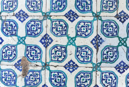 several ancient oriental ceramic tiles on a wall of mosque, rustem pasha, in istanbul, turkey. photo