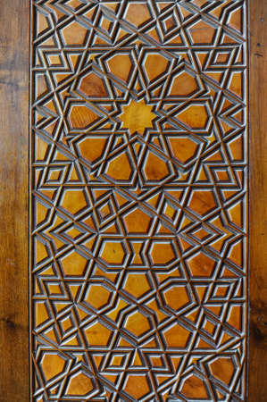 colored window: Islamic carvings on wooden surface of a golden colored window door in Sultan Ahmet mosque (Blue mosque) in Istanbul, Turkey