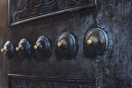 Decoration on mosque door  Round embossing weld on metal door  It is made of copper  Tips are yellow colored photo